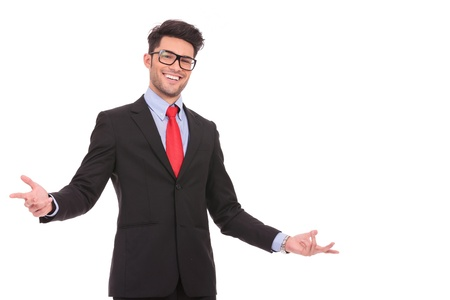 arms open: young business man wellcoming you with a big smile on his face, isolated on white Stock Photo