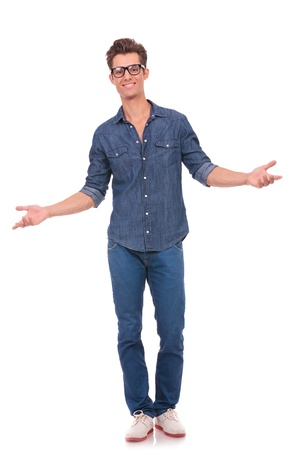welcoming: casual young man welcoming you with his arms opened and with a comforting smile. isolated on a white background