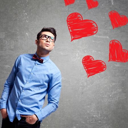 young business man looking up at some hearts photo