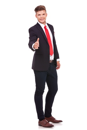acquaintance: full length picture of a young business man offering to shake hands with a smile on his face. isolated on white background Stock Photo