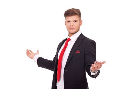 formalities: young business man welcoming you with his arms wide opened and looking at the camera. isolated on white background Stock Photo