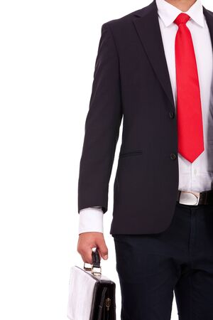 business briefcase: cutout picture of a young business man holding a briefcase. isolated on white background