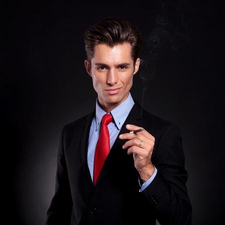 business man smokes cigarette photo
