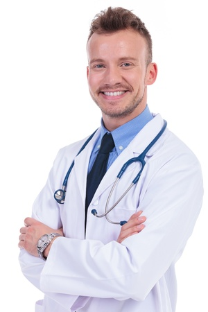 happy male doctor standing with hands crossed on a white background photo