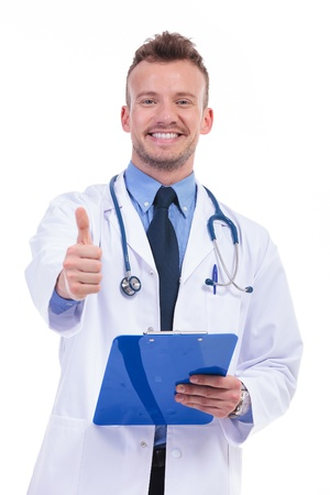 young doctor with good news making the ok thumbs up gesture photo