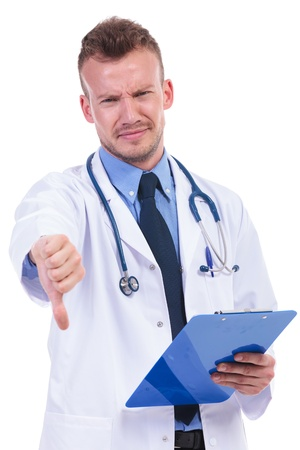 young doctor with very bad news making the negative thumbs down gesture photo