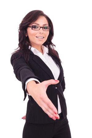 young business woman offering to shake hands with a smile on her face. on white background photo