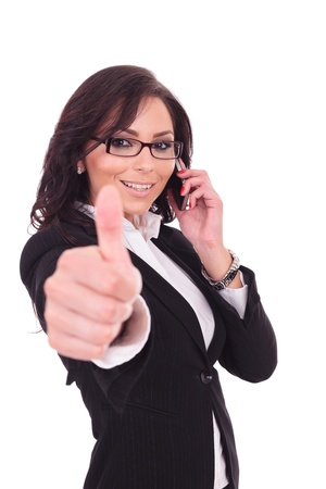 young business woman showing thumb up sign while speaking on the phone. on white background photo