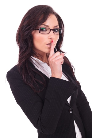 shut: young business woman making the shut up gesture with her finger at her mouth. on white background Stock Photo