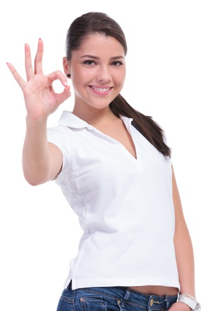 three people: casual young woman showing the ok sign to the camera and smiling. isolated on white background
