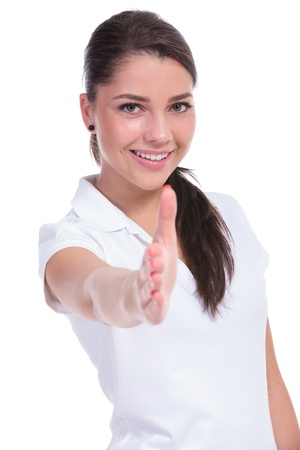 acquaintance: casual young woman offering you a handshake with a smile on her face. isolated on white background Stock Photo