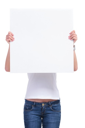 publicity: casual young woman holding an empty pannel in front of her face. isolated on white background
