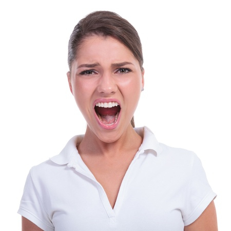 big mouth: casual young woman shouting at the camera with a big opened mouth. isolated on white background Stock Photo