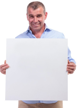 middle age man: casual senior man holding an empty banner while smiling for the camera. isolated on white background Stock Photo