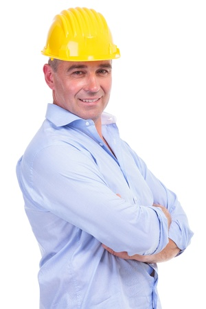 senior engineer standing with his arms crossed and smiling for the camera . isolated on white background photo