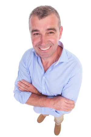 wide angle picture of a casual senior man  standing with his arms crossed and smiling for the camera. isolated on white background photo