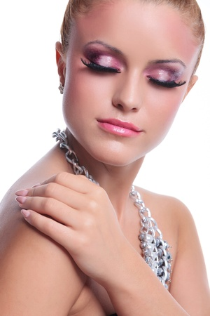 closeup of a young beauty woman touching her shoulder and keeping her eyes closed. on white background photo