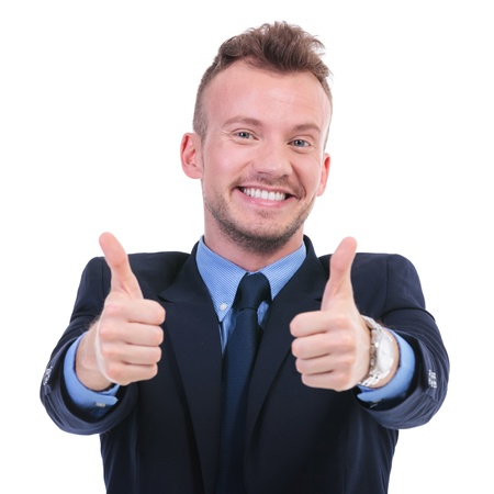 two thumbs up: young business man shows thumbs up with both hands while smiling. on white background