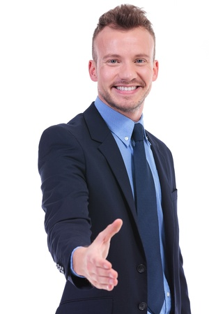acquaintance: young business man offering a handshake with a smile on his face. on white background