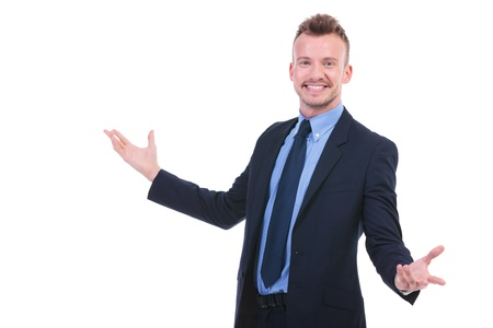 young business man welcoming everybody with a big smile on his face. on white background photo