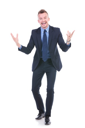 full length picture of a young business man telling a joke with his hands opened and with a big smile on his face while looking at the camera. on white background Stock Photo - 20482556