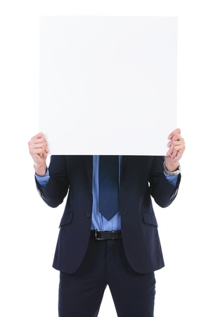 pannel: young business man holding a blank pannel in front of his face. on white background