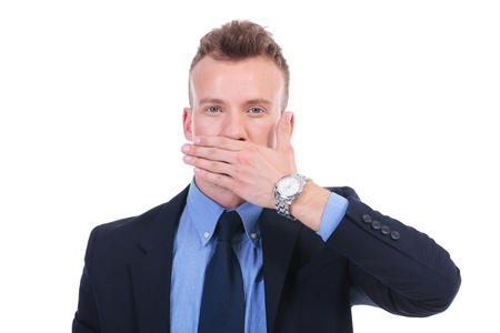 shut: young business man covering his mouth with his hand. speak no evil. on white background Stock Photo