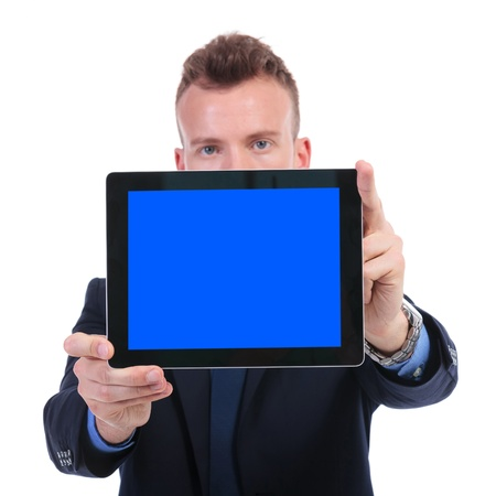 young business man presenting a blank blue screen tablet. on white background photo