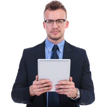 young business man holding a tablet while looking at the camera. on white background photo