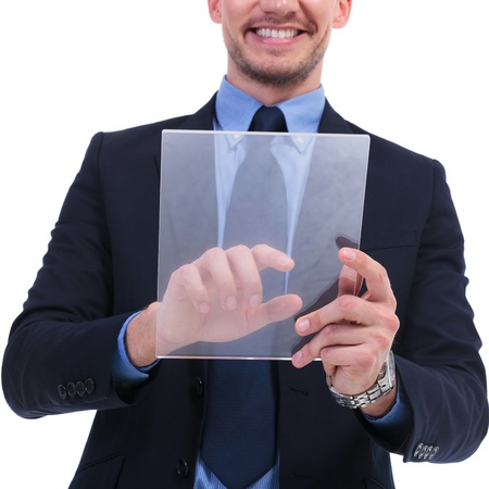 futuristic man: cutout of a young business man working on a translucid screen with a smile on his face. on white background Stock Photo
