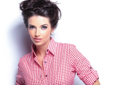 beauty woman: young beauty woman in red shirt and nice hairstyle looking at the camera