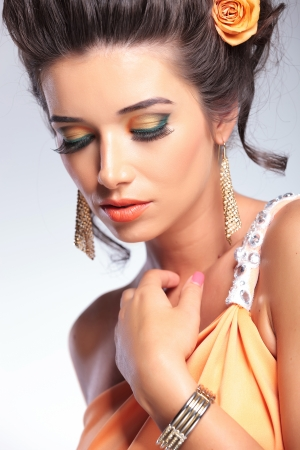 closeup of a young fashion woman looking down.