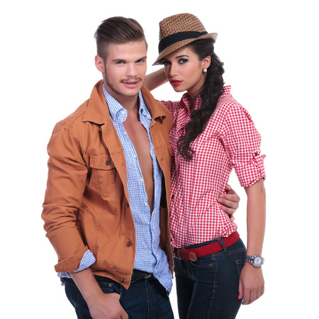 young casual couple with man holding woman and both looking at the camera. on white background Stock Photo - 22200986