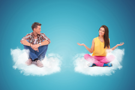 young man sitting on a cloud looking at a young woman welcoming you  photo