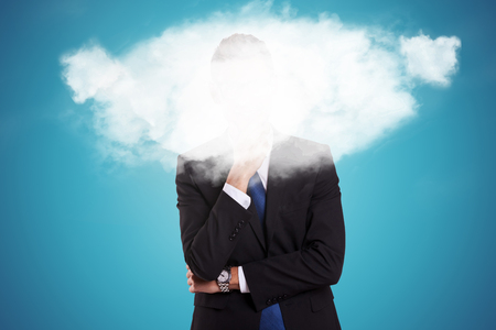 pensive young business man with a cloud over his face photo
