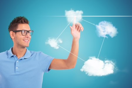 young casual student making his choice by pushing cloud shaped buttons  photo