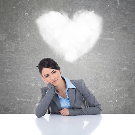 young business woman being in love and thinking of her happiness photo