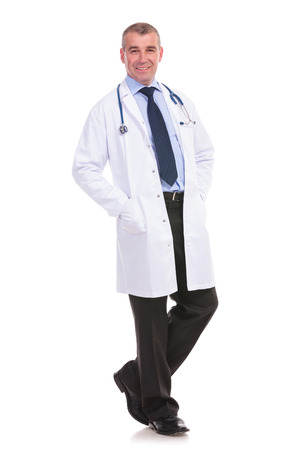 full uniform: relaxed mature doctor full body picture