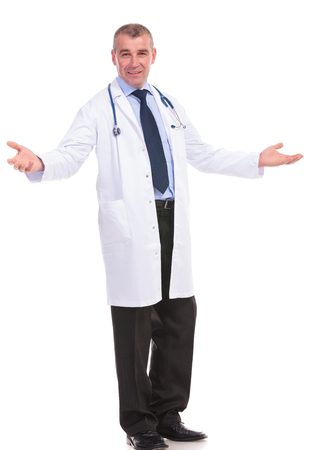 full body picture of an old doctor welcoming you for treatment photo