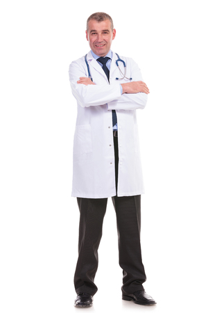 full body picture of an old doctor with arms crossed