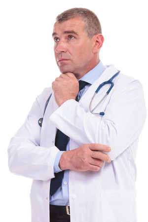 thoughtful old doctor wondering about the treatment for his pacients photo