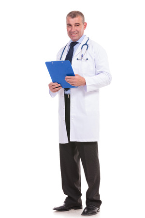 full body picture of a mature doctor holding a notepad photo