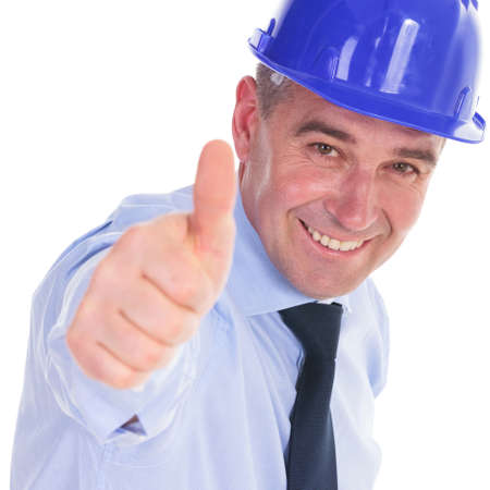 senior engineer showing you the thumbs up ok sign and smiling.  photo