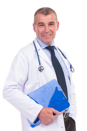 smiling old doctor holding a blue notepad  photo
