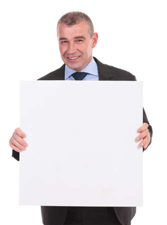 pannel: business man smiling for the camera while holding a small square pannel with both hands. on a white background