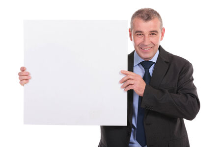 pannel: business man holding a blank pannel and smiling for the camera. on a white background