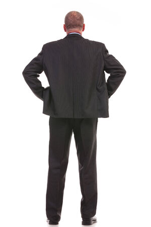 full length back view picture of a business man standing with his hands on his hips. on a white background photo
