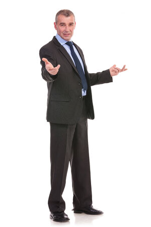 full length portrait of a business man walcoming you with his arms opened. on a white background photo