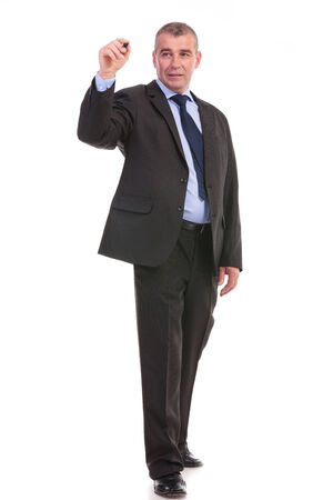 full length picture of a business man writing something on an imaginary screen. on a white background photo