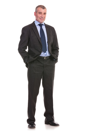 full length photo of a business man standing with his hands in his pockets and looking into the camera. on a white background photo